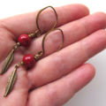 Feather red brass and enameled dangle earrings by Sasha+ Max