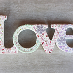 Timber Love Sign Mosaicked  in dainty pastel colours.......