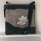 LINEN AND BLACK LEATHER APPLIQUED FLOWER