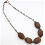 Oval dark wood coin bead and brass bead necklace with chain