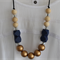 Gold, blue geometric, natural wood and crystal.