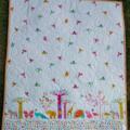 Kid's bright quilt featuring multicolored animal border