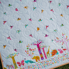 Kid's bright quilt featuring multicolored animal border