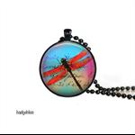 Dragonfly art pendant in black setting.