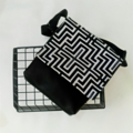 Black and white geometric feature flap vegan messenger bag