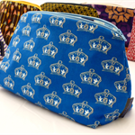 Medium zippered pouch or purse.  Crowns on a royal blue background.
