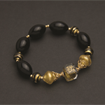 Murano glass gold and black beaded bracelet.