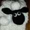 "White scarf with ""Shaun Sheep"" inspired face, also available in lime green"