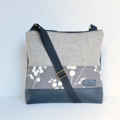 Large size 'Jodi' bag. Black vinyl, beige fabric with feature strip.