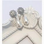 Rhodium plated rhinestone crystal earrings and Swarovski pearls