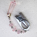 Folding scissors with pink prism and pink beads.