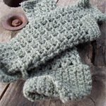 Crocheted fingerless mitts.  pure wool.  Pale olive lace with folded cuffs