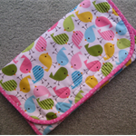 Baby Travel Change Mat with Pouches for Nappies and Wipes - Spring Birds