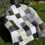 Black and white with gold patchwork quilt