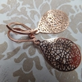 Rose Gold Lasercut Filigree Teardrops hung from Rose Gold Plated Leverback hooks