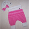 Pink stripe pants and hat.