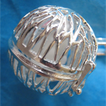 A silver plated cage pendant with tiny rabbit inside.