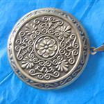 Large antique style locket.