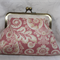 Pink scroll clutch bag