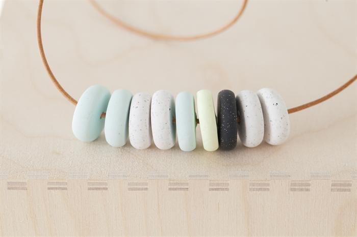 9 Disc Beads in Baby Blue, Light Lemon, Black and White