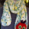 "Green scarf with red  ""Hungry Caterpillar"" inspired face"