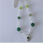 Delicate green jade and lampwork beaded necklace with charm