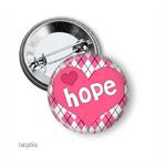 Breast cancer badge or magnet.