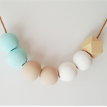 Mint and neutral polymer clay necklace with timber geometric bead