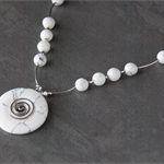Sterling silver white stone circle pendant necklace. Silver spiral necklace.