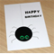 Happy Birthday card - black spider with pink or green eyes