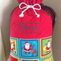 Personalised Santa Sack In Red and 'Jolly Santa' Fabric.