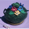 Floral green teapot cozy with pansies for large pot.