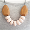 SEVEN ROUNDS necklace - peach clay with faceted wood feature