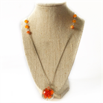 Elegant orange beaded necklace with lampwork flower charm