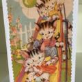 Kittens on a slide card