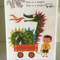 This is a dragon in a wagon card