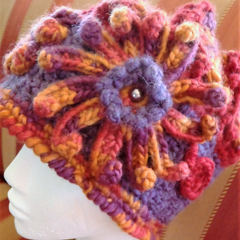 Crochet Cloche/Winter Pull On Hat/Beanie. Shades of red,purple and burnt orange