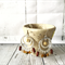 Silver hoop earrings with brown , cream and beige beads.