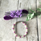 Purple and cream pearl beaded bracelet.