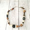 Brown, cream and beige beaded choker necklace.