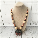 Beaded necklace with   diamond shaped wood charm.