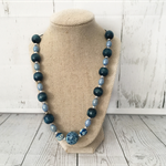Beaded necklace with royal blue beads and locean blue beads.