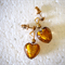 Amber hearts on gold studs