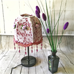 Maroon fabric covered  lampshade with white lace overlay and maroon beaded trim