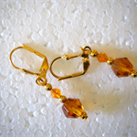 Amber bead, gold lever back earrings