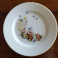 Hand decorated Royal Doulton plate with vintage decal of rabbits