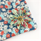 Cosmetics case / wash bag with detachable flower brooch - blue and coral