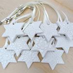 Christmas decorations, ornaments. White ceramic stars. Teachers gift.