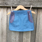 Faded denim skirt with contrast pockets, size 1