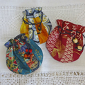 Listing for Penny.  Three Japanese Valuables Purse.   Free postage